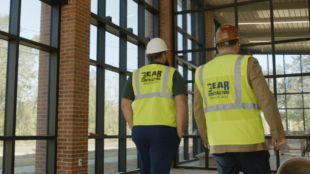 Photo of co-owners of Bear General Contractors Josh Sitton & Chris Jaubert walking through a job site