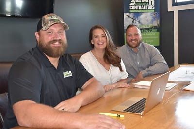 Photo of the Bear General Contractors team in the office