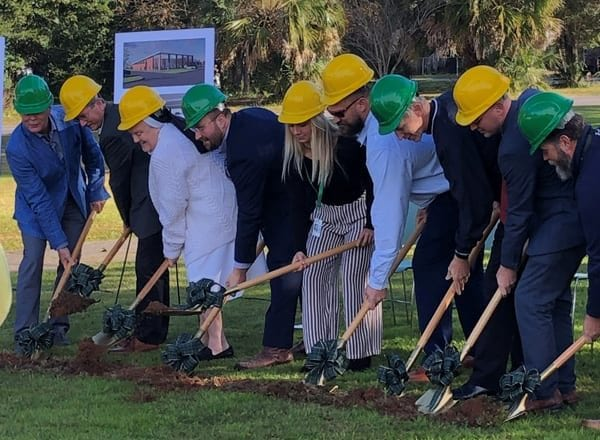 Photo of the Bear General Contractors team breaking ground for the Catholic High School commercial construction project
